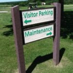 Sign at golf course director visitors to parking and maintenance