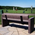 Bench at golf course driving range made with recycled plastic lumber