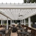 recycled plastic lumber pergola covering outdoor seating at country club