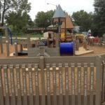 engraved boards at children's playground made with recycled plastic lumber