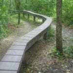 Raised park trail in forest made with recycled plastic lumber