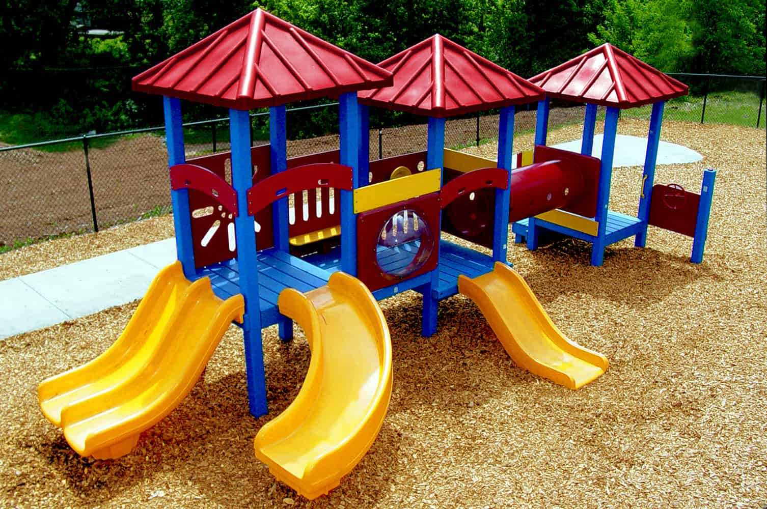 Small children's playground made with recycled plastic lumber