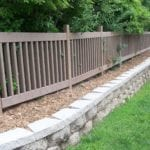 Composite fencing made with recycled plastic lumber