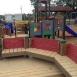 bench at childrens playgrounds made with recycled plastic lumber