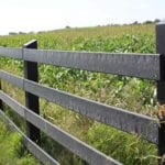 side view of fence made from recycled plastic lumber in agriculture setting