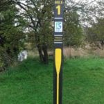 Mile marker at park made with composite plastic lumber