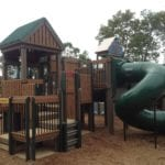 Children's playground engineered with recycled plastic lumber