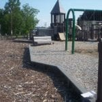Recycled plastic lumber lining the perimeter of a children's playground
