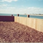 Marine retaining wall made with recycled plastic lumber