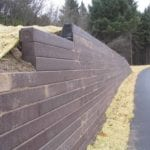recycled plastic retaining on wall near a public trail