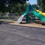 Children's playground with curb made out of recycled plastic