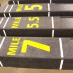 three mile marker signs made out of recycled plastic lumber