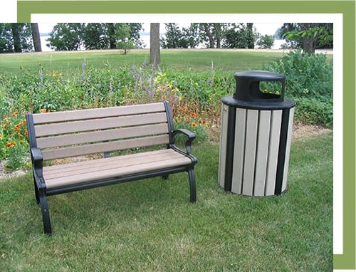 recycled plastic wood bench and trash can outdoors