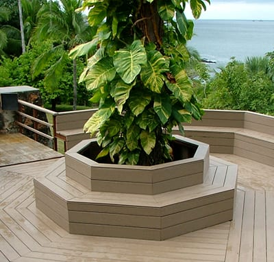 plastic wood deck with large plant in the middle