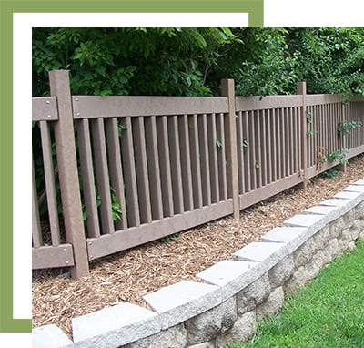 plastic wood fencing in a public park
