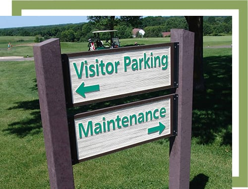 sign with visitor parking pointing left and maintenance pointing right