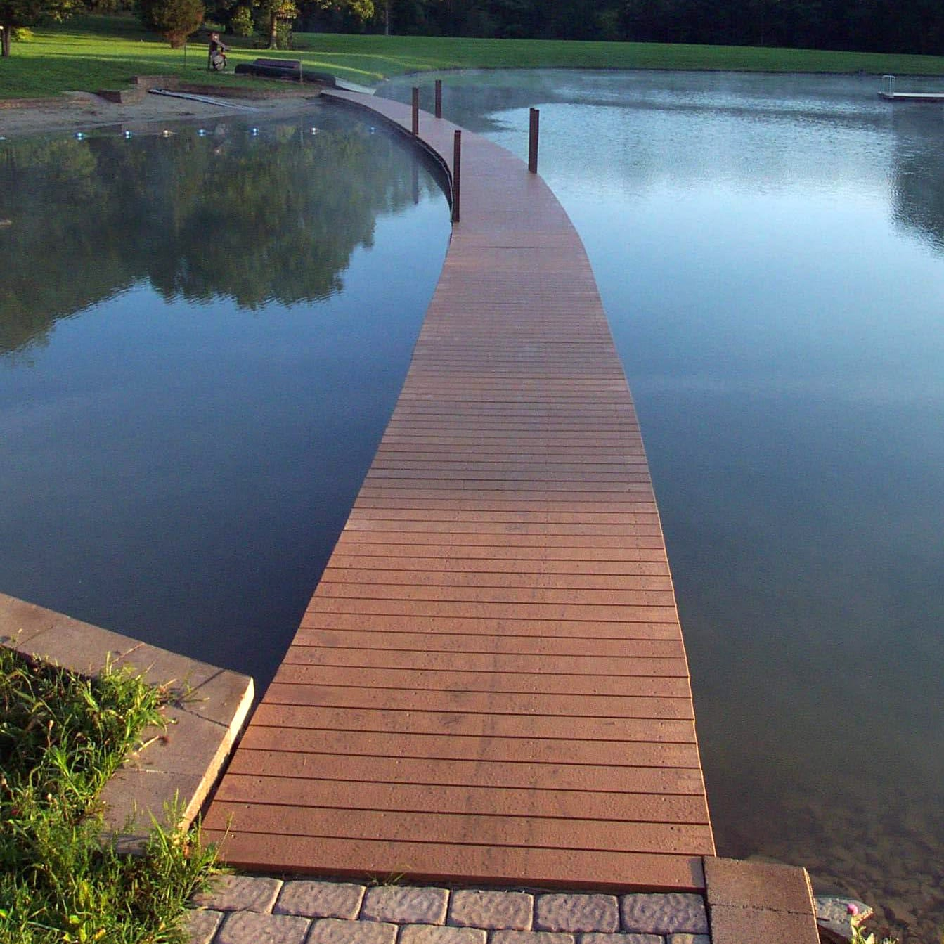 plastic lumber boardwalk over small lake